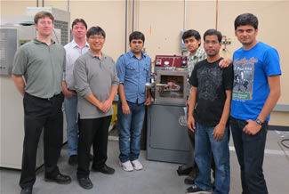 PHD students at North Texas University, right, pose with the Arc200, and, left the Arcast team and the instructor